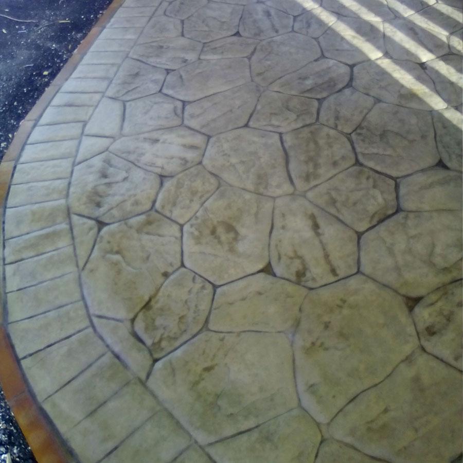Tecnopav pavimenti per esterni in cemento stampato in for Pavimento in cemento